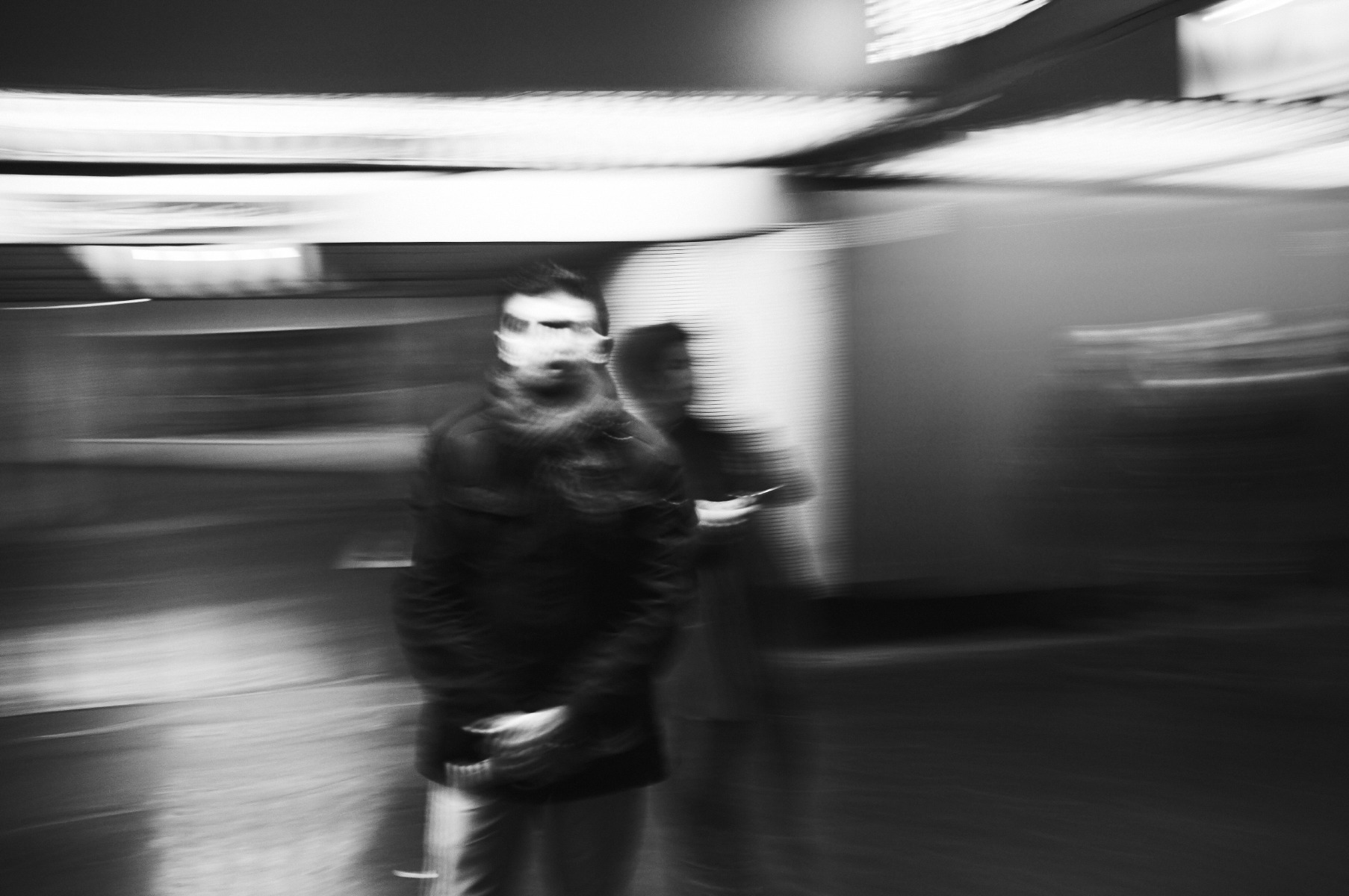 Man waiting on a plateform by Emmanuel Pineau
